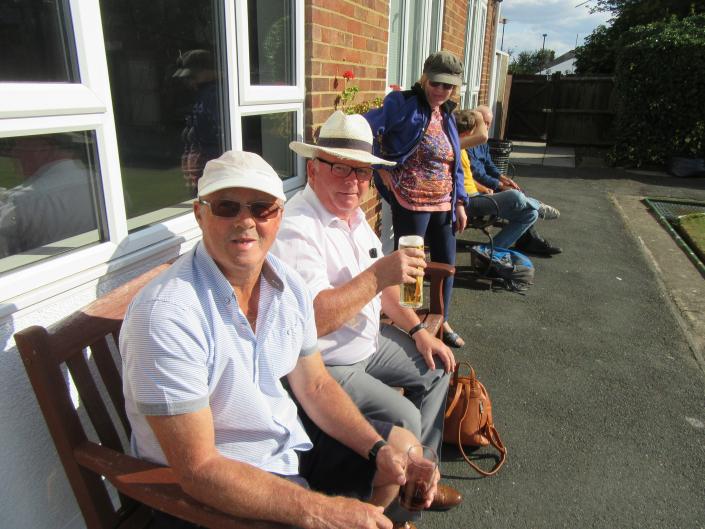Spectators enjoying a beer