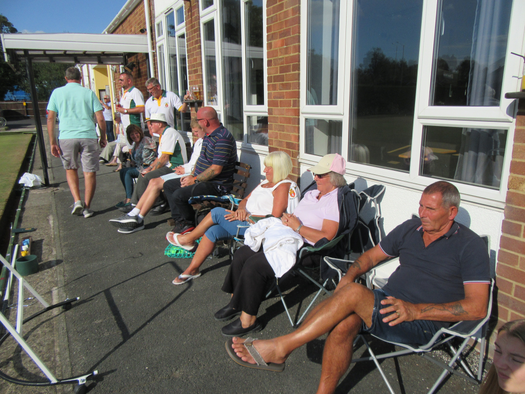 Spectators sitting in chairs on a sunny day in 2019