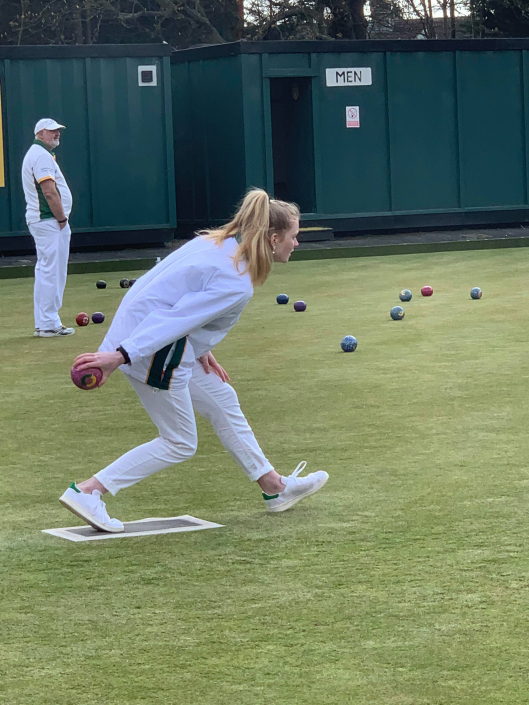 a lady bowling