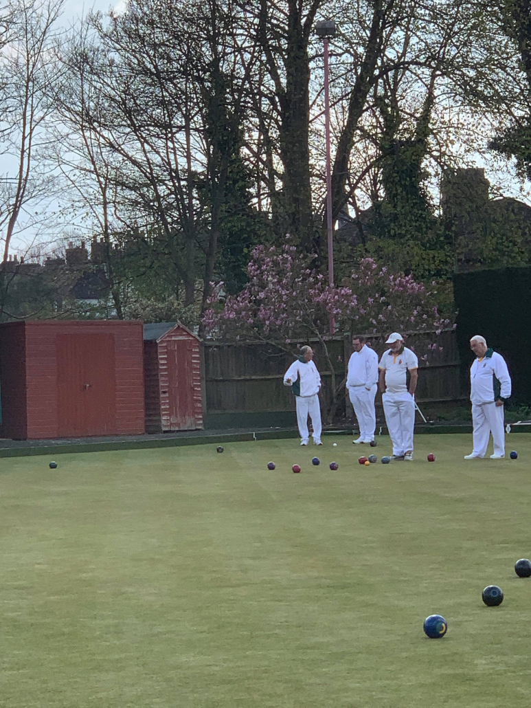 a group of bowlers looking at the game