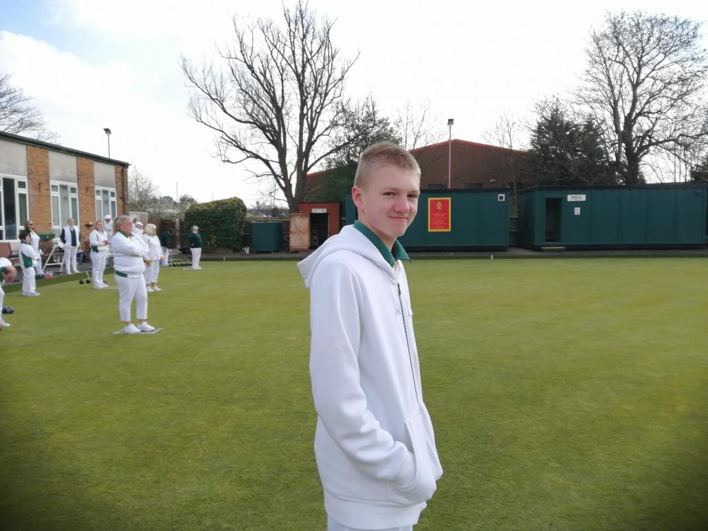 a young man bowler